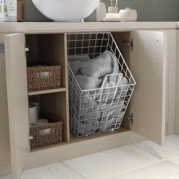 Tilting linen basket
