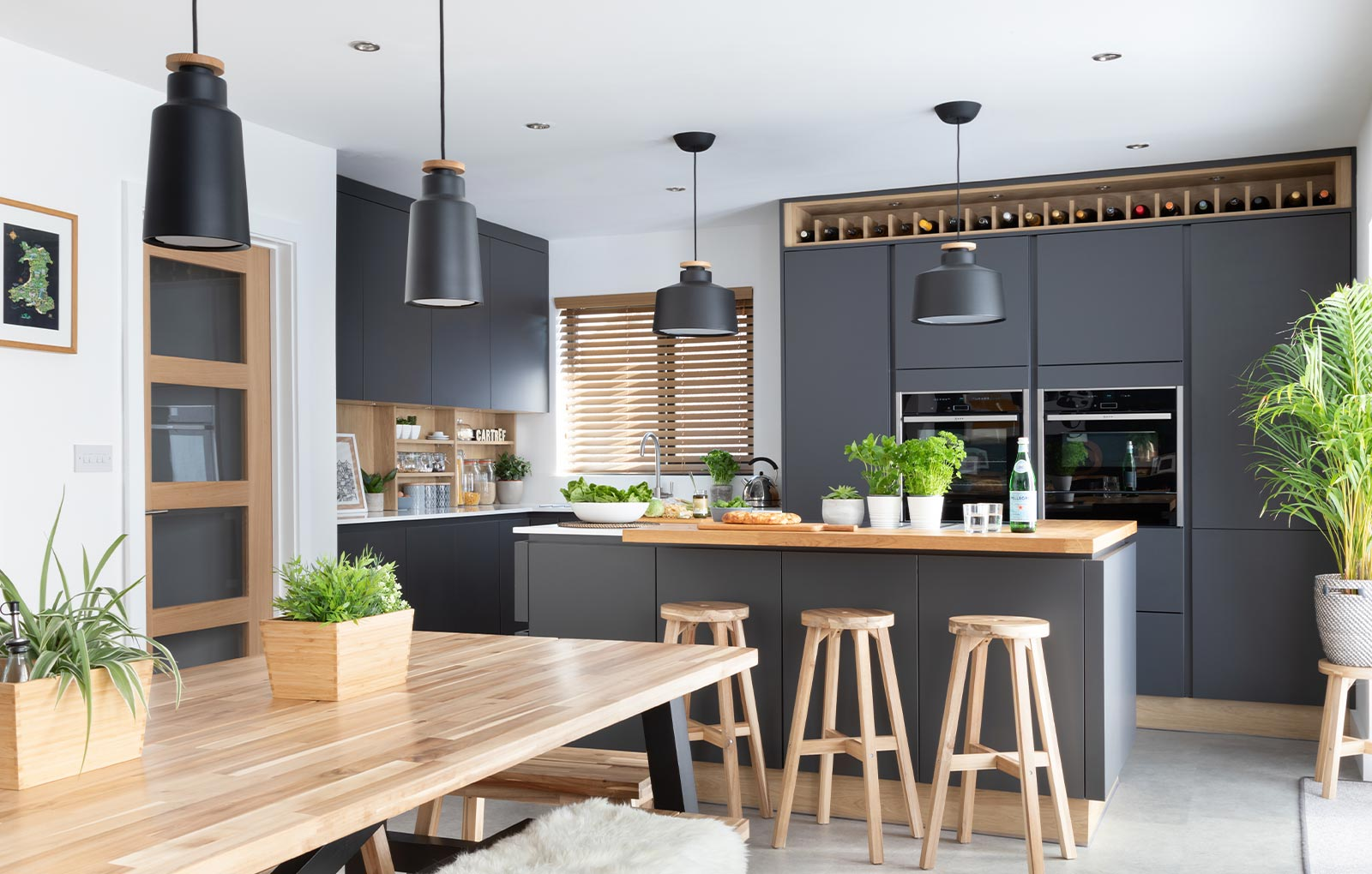 Modern dark kitchen with wood accents