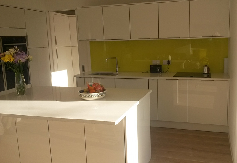 Lumina White glass edge with Quartz worktops