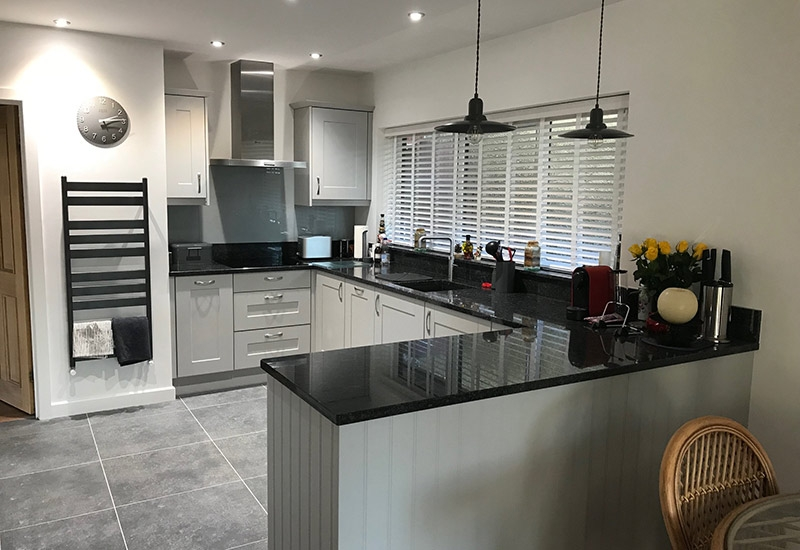 Maine Grained Light Grey with Steel Grey Quartz worktops