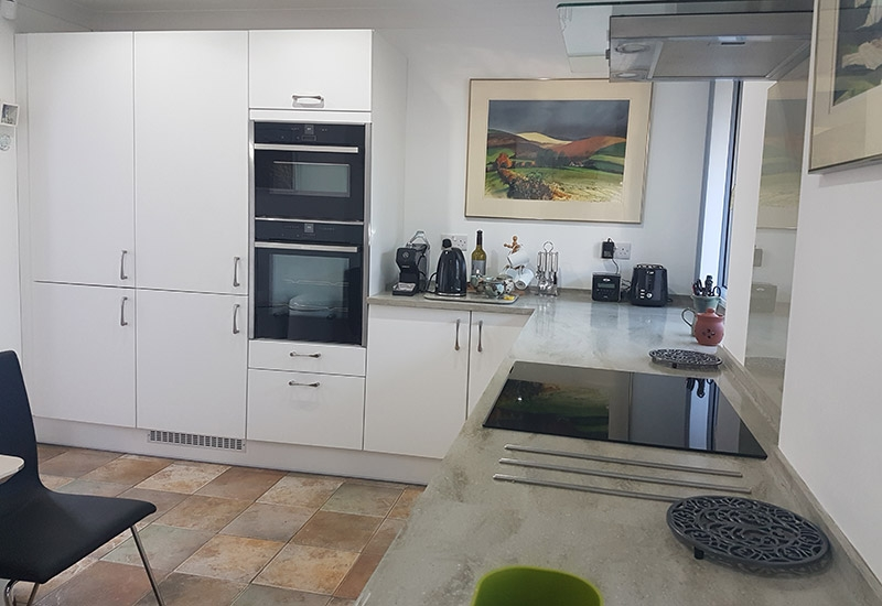 Reno White with Corian Sagebrush Worktops
