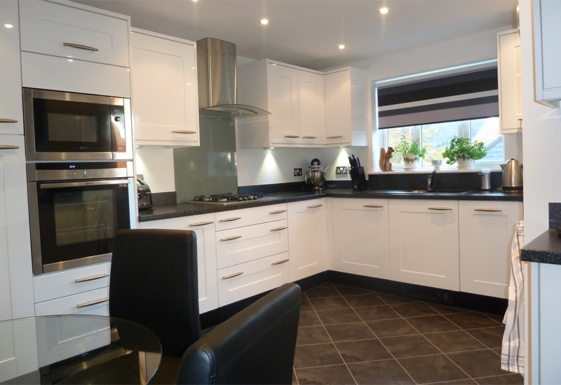 Seville White Gloss with Astral Quartz Laminate worktops