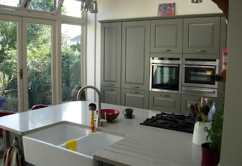 Fairmont Sage Green With Quartz Phoenix Sand Worktops
